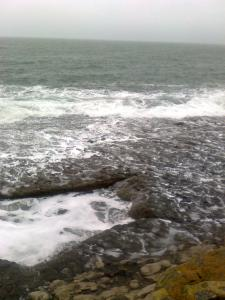 Waves rushing over rocky ground